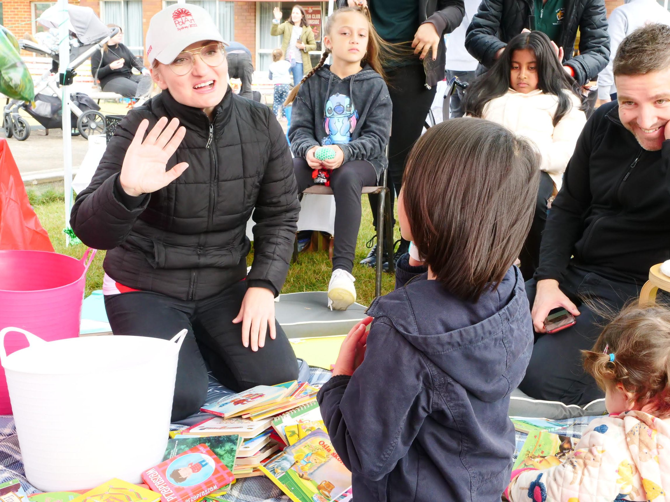Photo of Ewelina during story time at Children's Day